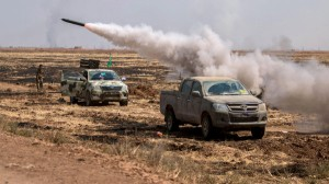 Kurdish fighters fire shells towards what they said were Islamic State strongholds in Tel Abyad of Raqqa governorate after they said they took control of the area June 15, 2015. Syrian Kurdish-led forces said they had captured a town at the Turkish border from Islamic State on Monday, driving it away from the frontier in an advance backed by U.S.-led air strikes that has thrust deep into the jihadists' Syria stronghold. The capture of Tel Abyad by the Kurdish YPG and smaller Syrian rebel groups means the Syrian Kurds effectively control some 400 km (250 miles) of the Syrian-Turkish border that has been a conduit for foreign fighters joining Islamic State. Picture taken June 15, 2015. REUTERS/Rodi Said